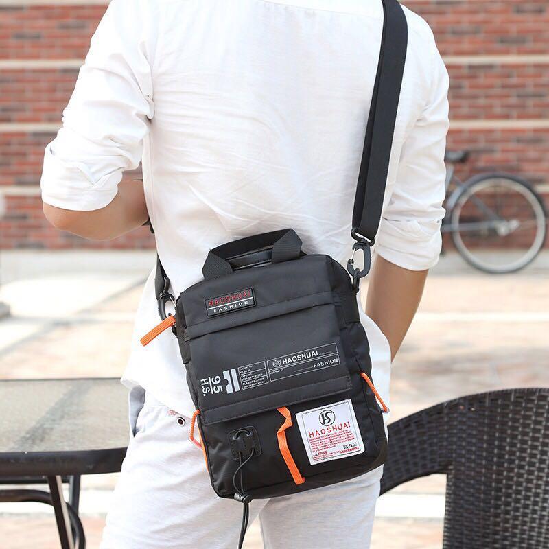 新款休闲单肩包男女通用手提单肩包斜挎包优惠券