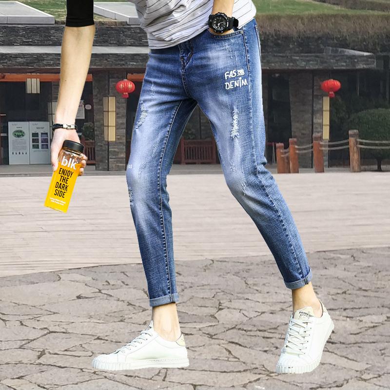 韩版修身弹力绣花贴布牛仔小脚裤优惠券